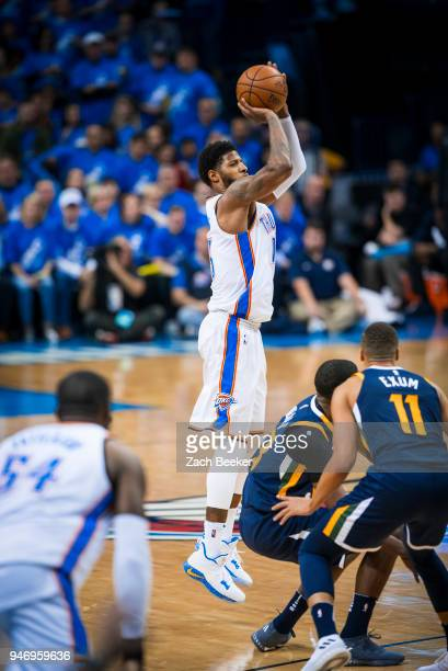 Paul George of the Oklahoma City Thunder shoots the ball against the Utah Jazz during Game one and Round one of the 2018 NBA Playoffs on April 15...