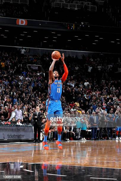 Paul George of the Oklahoma City Thunder shoots the gamewinning shot against the Brooklyn Nets on December 5 2018 at Barclays Center in Brooklyn New...