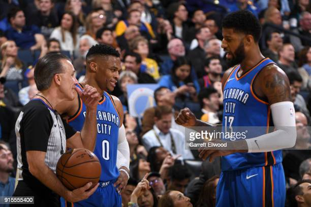 Paul George of the Oklahoma City Thunder speaks to Russell Westbrook of the Oklahoma City Thunder during the game against the Golden State Warriors...