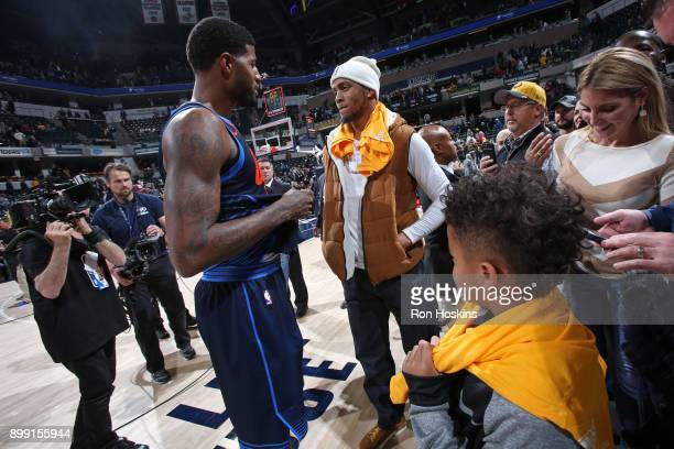 Paul George of the Oklahoma City Thunder speaks with former NBA player Monta Ellis after the game against the Indiana Pacers on December 13 2017 at...
