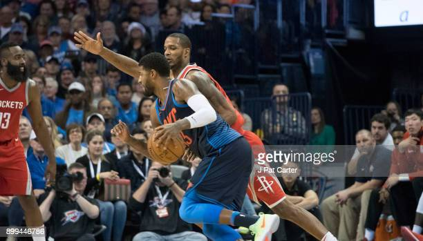 Paul George of the Oklahoma City Thunder tries to out run Trevor Ariza of the Houston Rockets during the second half of a NBA game at the Chesapeake...