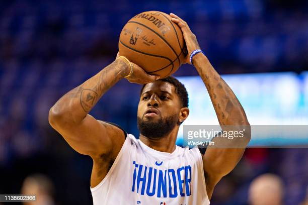 Paul George of the Oklahoma City Thunder warms up before a game against the Portland Trail Blazers during Round One Game Three of the 2019 NBA...