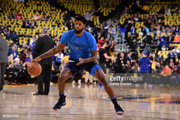 Paul George of the Oklahoma City Thunder warms up before the game against the Golden State Warriors on February 24 2018 at Oracle Arena in Oakland...