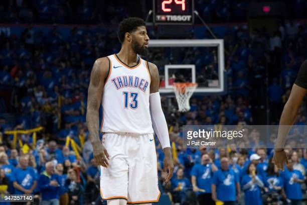 Paul George of the Oklahoma City Thunder watches action Utah Jazz during the second half of Game One of the Western Conference in the 2018 NBA...