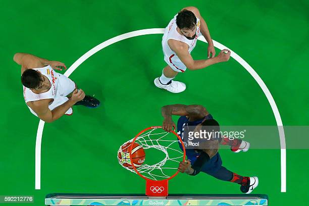 Paul George of United States dunks against Guillermo Hernangomez Geuer and Sergio Llull of Spain during the Men's Semifinal match on Day 14 of the...