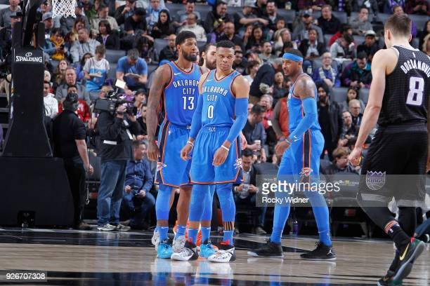 Paul George Russell Westbrook and Carmelo Anthony of the Oklahoma City Thunder face the Sacramento Kings on February 22 2018 at Golden 1 Center in...