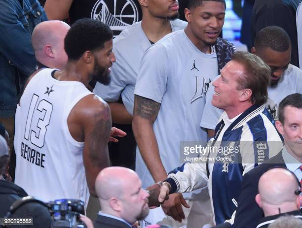 Paul George shakes Arnold Schwarzenegger's hand during the NBA AllStar Game 2018 at Staples Center on February 18 2018 in Los Angeles California