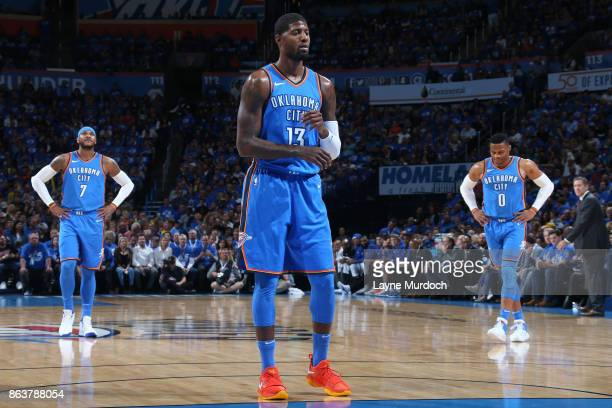 Paul George shoots a foul shot while Carmelo Anthony and Russell Westbrook of the Oklahoma City Thunder look during the game against the New York...