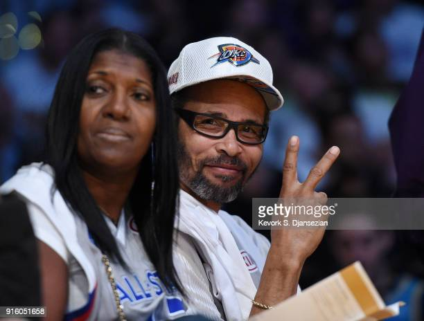 Paul George Sr and Paulette George parents of basketball player Paul George of the Oklahoma City Thunder attend a basketball game between the...