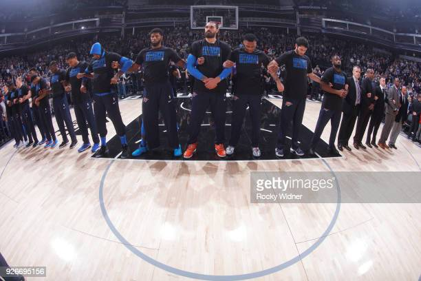 Paul George Steven Adams and Russell Westbrook link arms with teammates for the national anthem of the game against the Sacramento Kings on February...