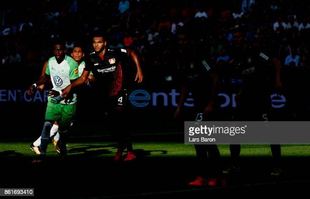 Paul Georges Ntep of Wolfsburg is blocked by Jonathan Tah of Leverkusen during the Bundesliga match between Bayer 04 Leverkusen and VfL Wolfsburg at...