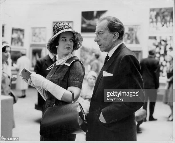 Paul Getty and his English solicitor, Robina Lund, at the Royal Academy's 193rd Summer Exhibition, London, April 28th 1961.