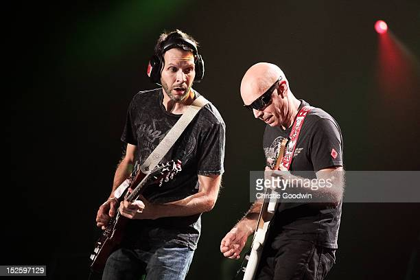 Paul Gilbert and Joe Satriani perform on stage during the Marshall 50 Years Of Loud concert celebrating Marshall Amplifiers 50th anniversary at...