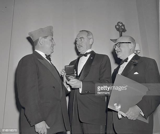 Paul Ginsberg the National Commander for Jewish War Veterans presents the Jewish War Veteran's 1951 Gold Medal of Merit for distinguished services in...
