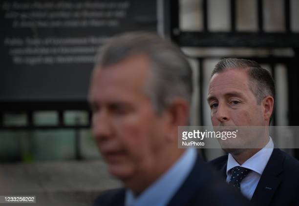 Paul Givan listens to DUP Leader Edwin Poots speaking to the media outside Government Buildings in Dublin after meeting Taoiseach Micheal Martin . On...