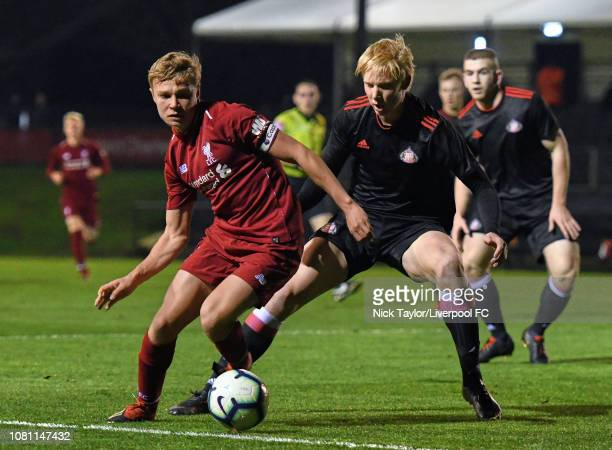 Paul Glatzel of Liverpool and Andrias Edmundsson of Sunderland in action during the U18 Premier League game at The Kirkby Academy on January 11 2019...