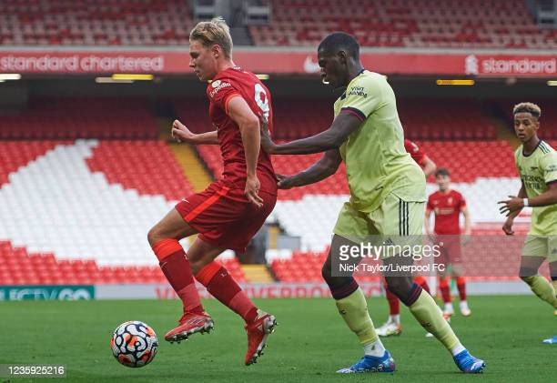 Paul Glatzel of Liverpool and Mazeed Ogungbo of Arsenal in action during the PL2 game at Anfield on October 16, 2021 in Liverpool, England.