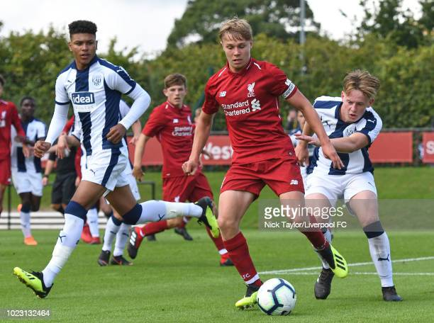 Paul Glatzel of Liverpool and Peter Taylor of West Bromwich Albion in action during the Liverpool U18 v West Bromwich Albion U18 game at The Kirkby...