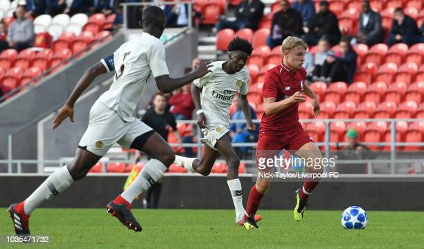 Paul Glatzel of Liverpool and Raphael Nya of Paris SaintGermain in action during the UEFA Youth League game at Langtree Park on September 18 2018 in...