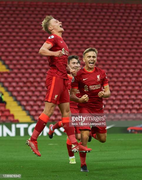 Paul Glatzel of Liverpool celebrates scoring Liverpool's second goal with James Norris during the PL2 game at Anfield on October 16, 2021 in...