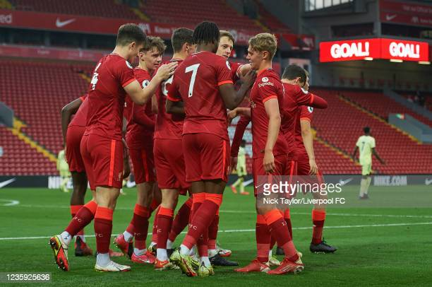 Paul Glatzel of Liverpool celebrates scoring Liverpool's second goal with team mates during the PL2 game at Anfield on October 16, 2021 in Liverpool,...