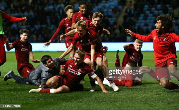 Paul Glatzel the captain of Liverpool is mobbed by team mates after scoring the winning penalty during a penalty shoot out in the FA Youth Cup Final...