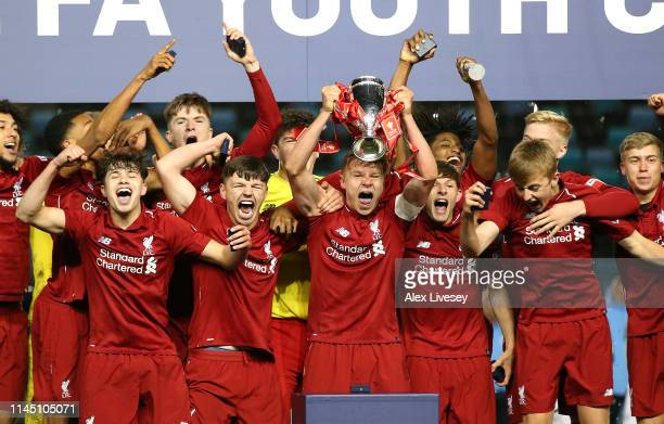Paul Glatzel the captain of Liverpool lifts the FA Youth Trophy after victory in the FA Youth Cup Final between Manchester City and Liverpool at...