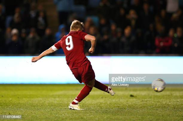 Paul Glatzel the captain of Liverpool scores the winning penalty during a penalty shoot out in the FA Youth Cup Final between Manchester City and...