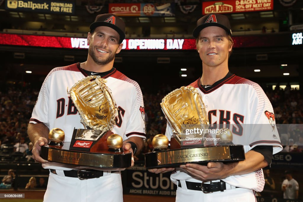 Paul Goldschmidt #44 and Zack Greinke #21 of the Arizona Diamondbacks pose with their golden glove awards before the opening day MLB game against the Colorado Rockies at Chase Field on March 29, 2018 in Phoenix, Arizona.