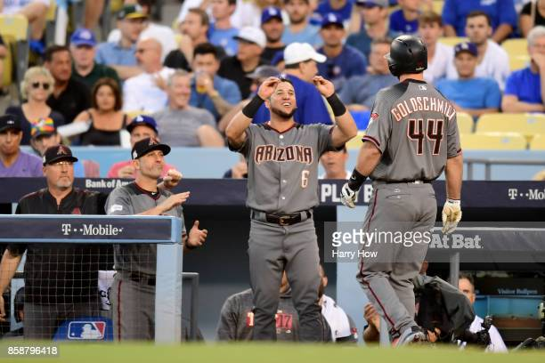 Paul Goldschmidt is congratulated by his teammate David Peralta of the Arizona Diamondbacks after hitting a first inning two run home run against the...