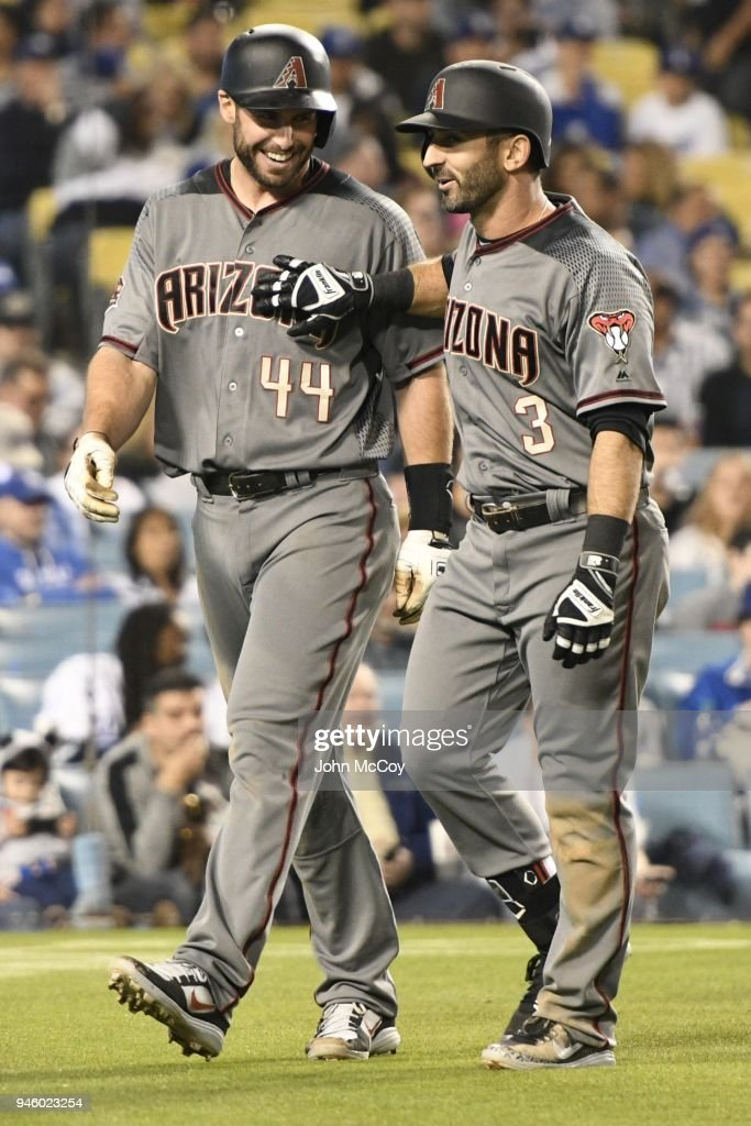 Paul Goldschmidt #44 of the Arizona Diamondbacks and Daniel Descalso #3 home after Descaiso hit a 2 run homer in the 7th inning against the Los Angeles Dodgers at Dodger Stadium on April 13, 2018 in Los Angeles, California.