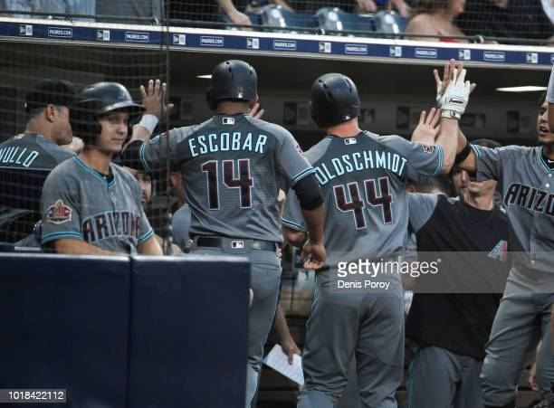 Eduardo Escobar of the Arizona Diamondbacks hits a solo home run during the eighth inning of a baseball game against the San Diego Padres at PETCO...