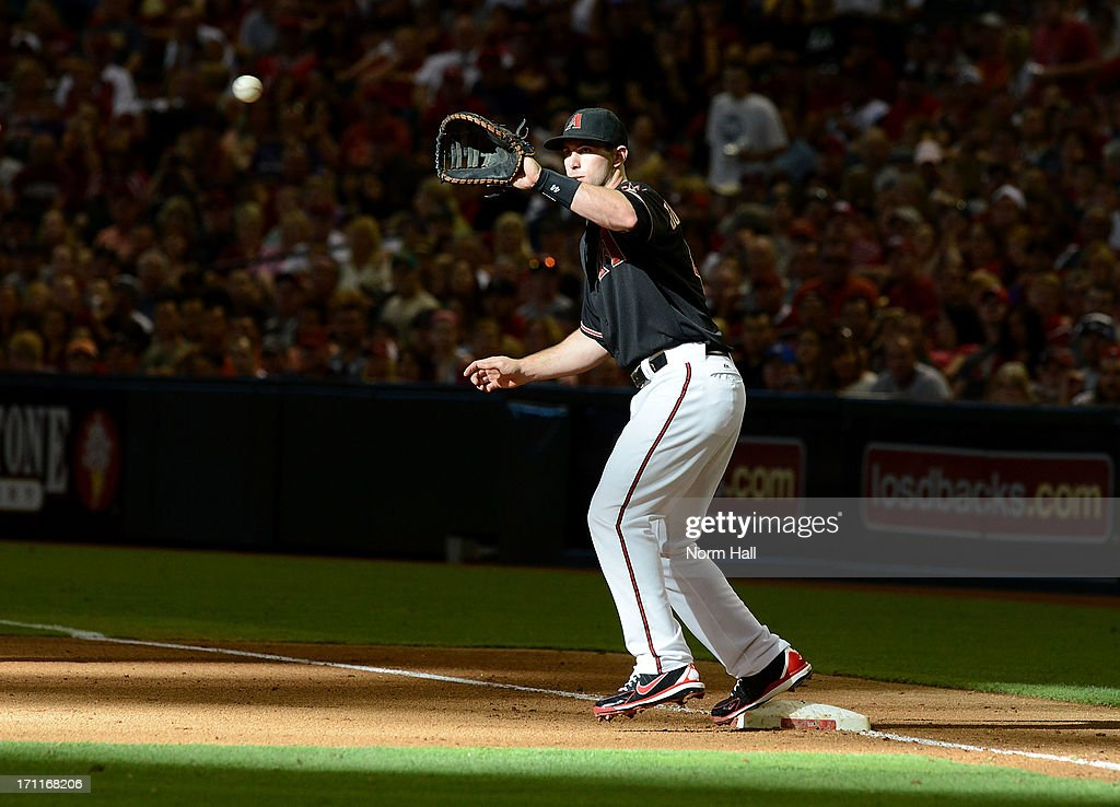Paul Goldschmidt #44 of the Arizona Diamondbacks catches a throw while covering first base against the Cincinnati Reds at Chase Field on June 22, 2013 in Phoenix, Arizona.