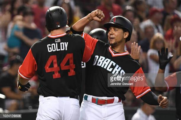 Paul Goldschmidt of the Arizona Diamondbacks celebrates a three run home run with Jon Jay in the third inning of the MLB game against the Seattle...
