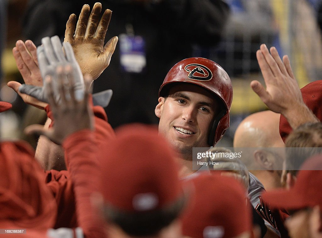 Paul Goldschmidt #44 of the Arizona Diamondbacks celebrates his two run hoomerun with the dugout to take a 5-3 lead over the Los Angeles Dodgers during the ninth inning at Dodger Stadium on May 7, 2013 in Los Angeles, California.