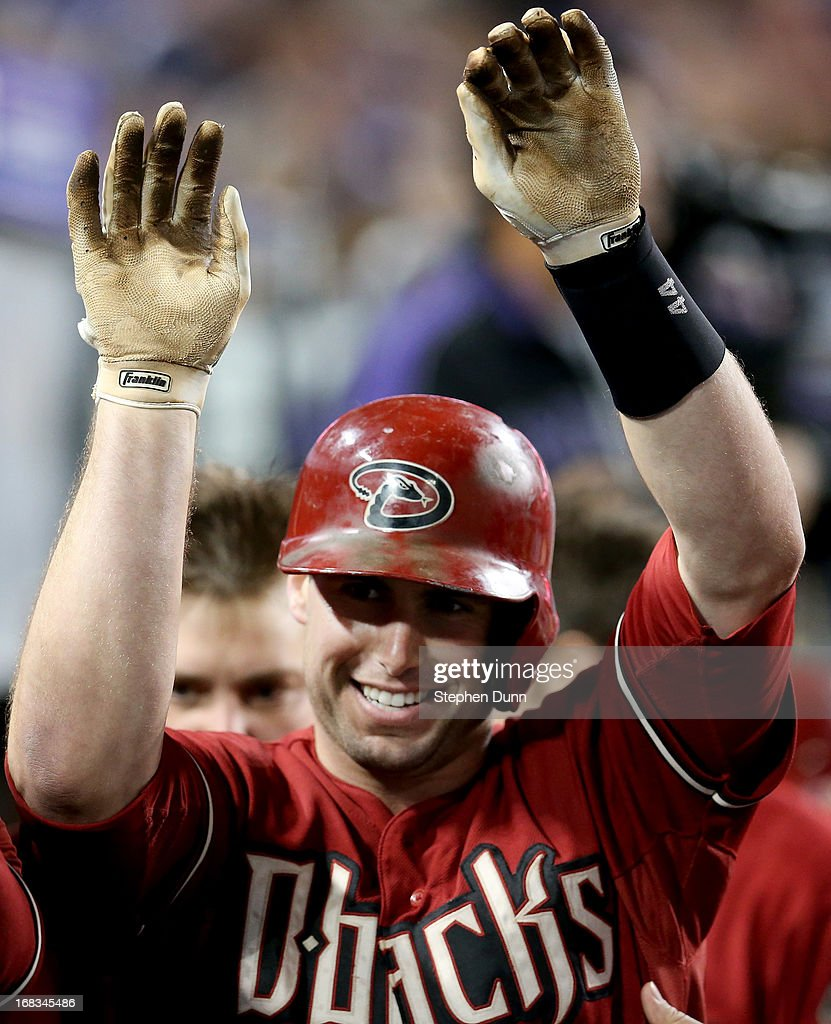 Paul Goldschmidt #44 of the Arizona Diamondbacks celebrates in the dugout after hitting his second home run of the game against the Los Angeles Dodgers to give the Diamodnbacks a one run lead in the eighth inning at Dodger Stadium on May 8, 2013 in Los Angeles, California.