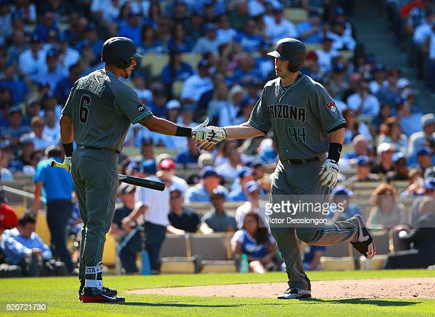 Paul Goldschmidt of the Arizona Diamondbacks celebrates with teammate David Peralta after Goldschmidt hit a solo homerun in the eighth inning against...