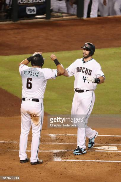 Paul Goldschmidt of the Arizona Diamondbacks celebrates with teammate David Peralta after Goldschmidt's threerun home run during the bottom of the...