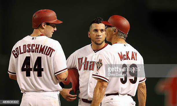 Paul Goldschmidt of the Arizona Diamondbacks David Peralta and first base coach Dave McKay talk during a break in the bottom of the sixth inning of...