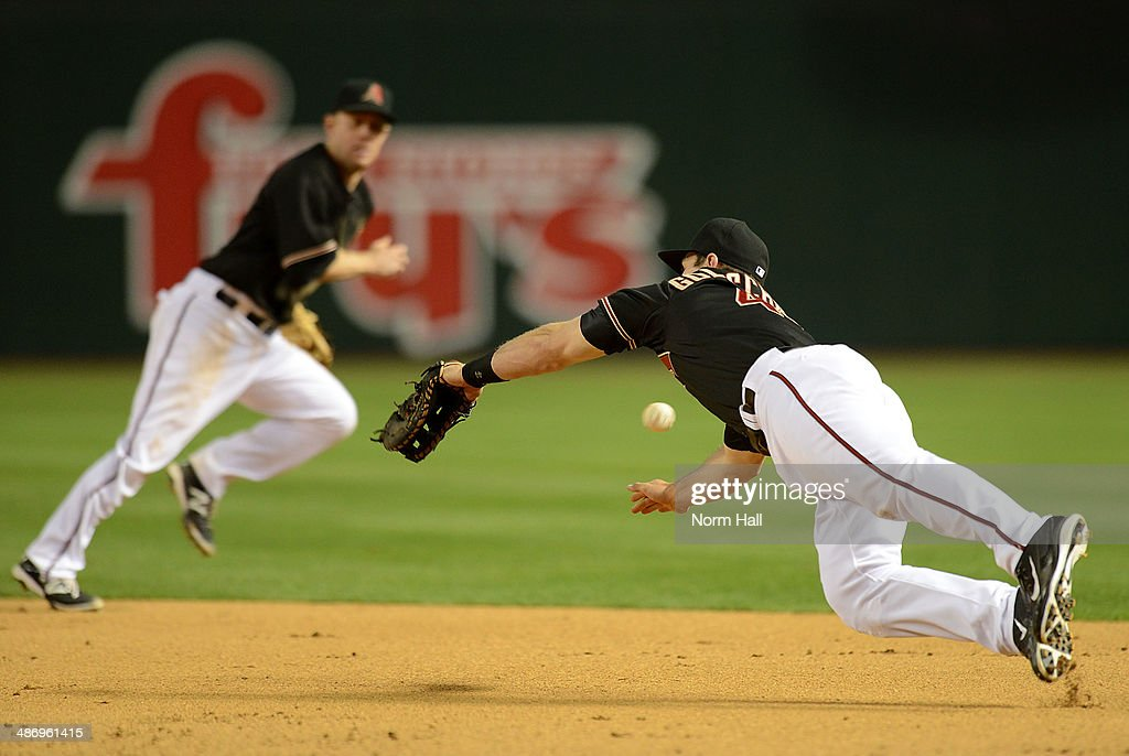 Paul Goldschmidt #44 of the Arizona Diamondbacks dives for a ball in the eighth inning against the Philadelphia Phillies at Chase Field on April 26, 2014 in Phoenix, Arizona.