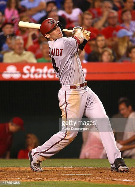 Paul Goldschmidt of the Arizona Diamondbacks hits a fly ball out to deep right in the ninth inning during the MLB game against the Los Angeles Angels...