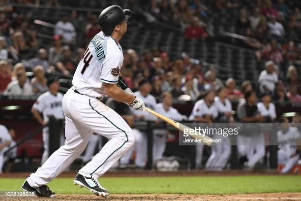 Paul Goldschmidt of the Arizona Diamondbacks hits a solo home run in the ninth inning of the MLB game against the Atlanta Braves at Chase Field on...