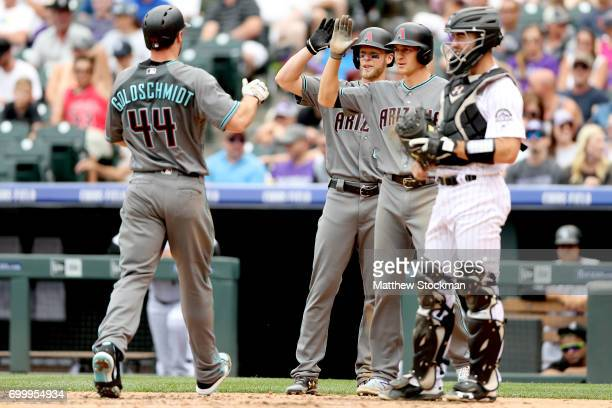Paul Goldschmidt of the Arizona Diamondbacks is congratulated at the plate by Jeremy Hazelbaker and Nick Ahmed after hitting a 3 RBI home run in the...