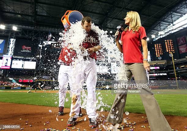 Paul Goldschmidt of the Arizona Diamondbacks is dunked by water as he is interviewed by Jody Jackson about his game winning RBI single against the...