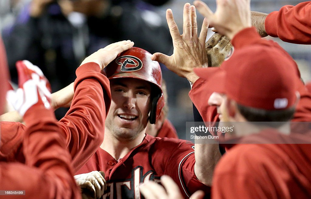 Paul Goldschmidt #44 of the Arizona Diamondbacks is greeted by teammates in the dugout after hitting his second home run of the game against the Los Angeles Dodgers to give the Diamodnbacks a one run lead in the eighth inning at Dodger Stadium on May 8, 2013 in Los Angeles, California.