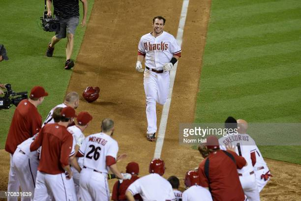 Paul Goldschmidt of the Arizona Diamondbacks is greeted by teammates at home plate after hitting a walkoff gamewinning home run against the Miami...