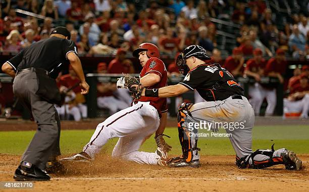 Paul Goldschmidt of the Arizona Diamondbacks is tagged out at home plate by catcher JT Realmuto of the Miami Marlins during the eighth inning of the...