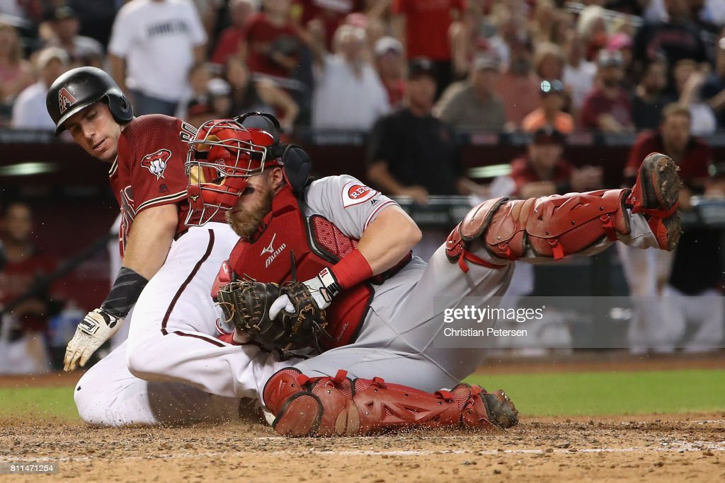 Paul Goldschmidt #44 of the Arizona Diamondbacks is tagged out at home plate by catcher Tucker Barnhart #16 of the Cincinnati Reds during the sixth inning of the MLB game at Chase Field on July 9, 2017 in Phoenix, Arizona.