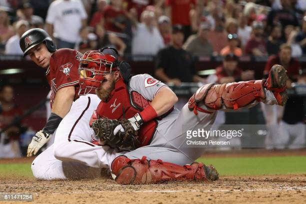 Paul Goldschmidt of the Arizona Diamondbacks is tagged out at home plate by catcher Tucker Barnhart of the Cincinnati Reds during the sixth inning of...
