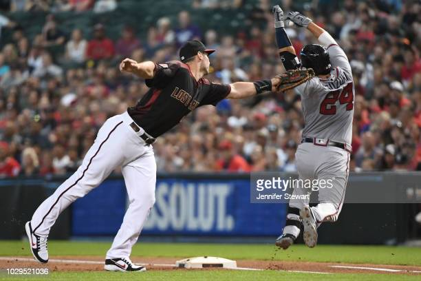 Paul Goldschmidt of the Arizona Diamondbacks makes the tag on Kurt Suzuki of the Atlanta Braves in the first inning of the MLB game at Chase Field on...